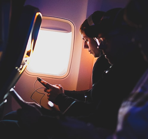 Man listening to audiobooks on an airplane
